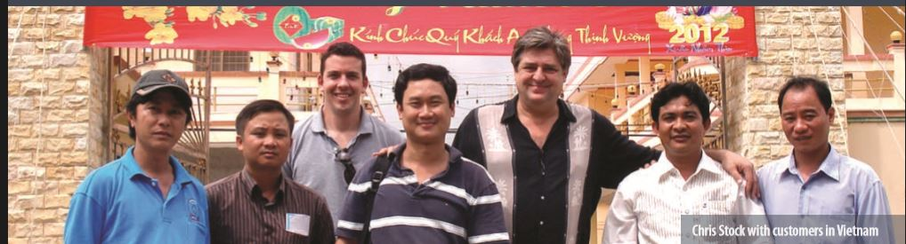 Chris Stock with customers in Vietnam